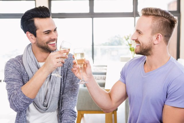 Smiling gay couple