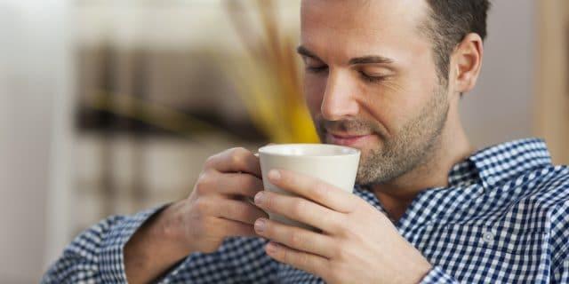man drinks coffee