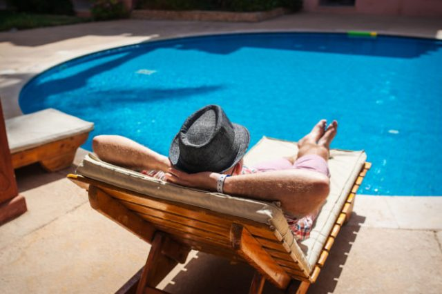 man-by-pool