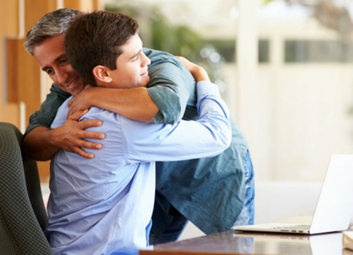 Dad-hugging-teen-son