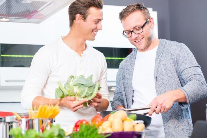 Friends cooking vegies