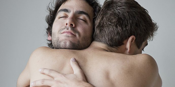 Gay male couple embracing