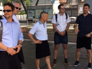 Bus drivers and school boys wear skirts after being banned from wearing shorts in hot weather
