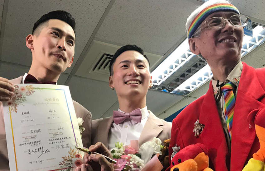 Gay couple Shane and Marc with veteran LGBTI rights campaigner Chi Chia-wei (Photo: Rik Glauert)
