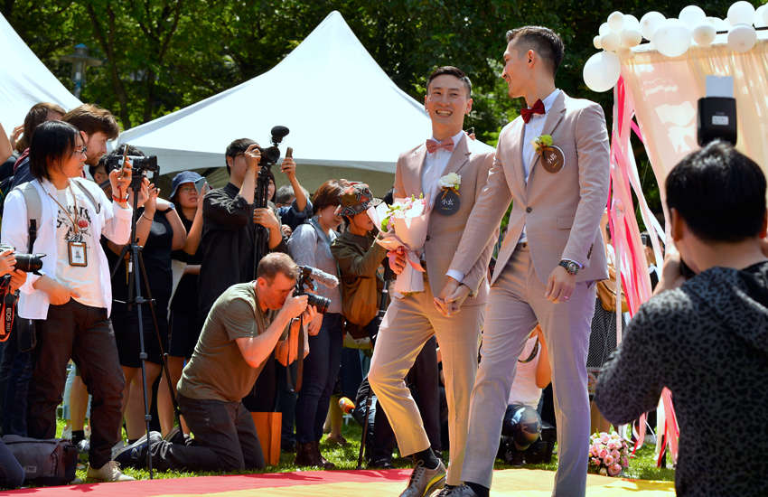 Marc and Shane walk down the aisle after getting married (Photo: Provided)