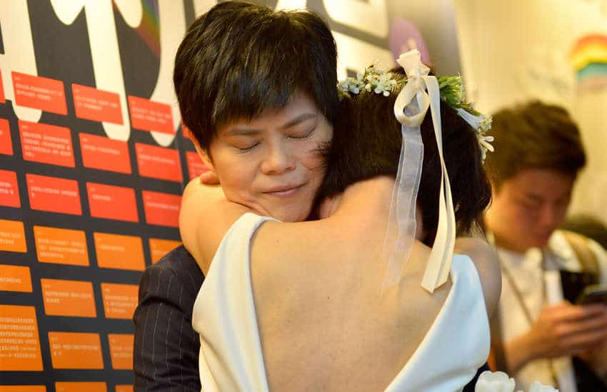 Xue and Antonia Chen share an embrace after getting married (Photo: Provided)