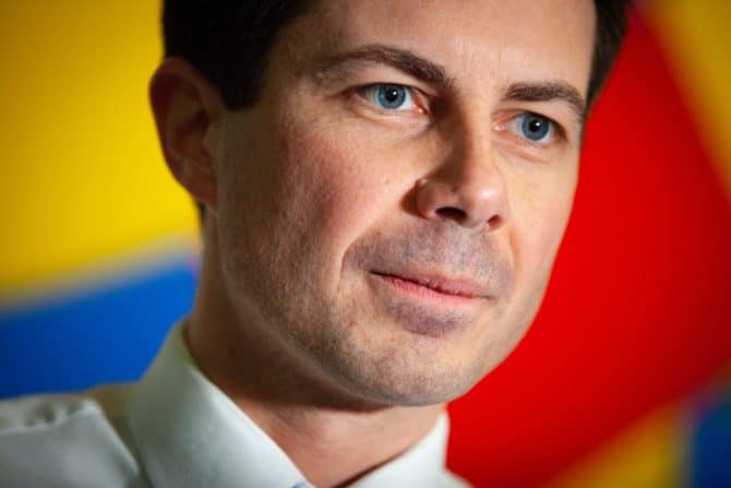 Pete Buttigieg in front of a colorful wall