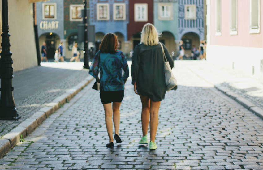 Two women walking down the street