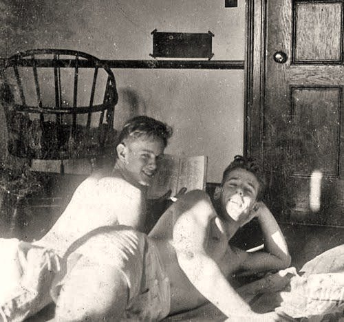 A gay couple cuddling in their home.