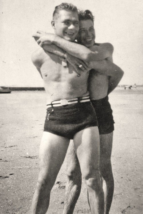 A cute gay couple posing for a photo.