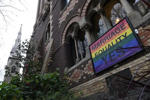 A marriage equality sign posted outside St Michael's Uniting Church  in the Melbourne CBD last year. Picture: AAP